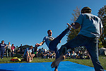 Lawrance Greene, center, and Weston Lombard, right, demonstrate the art of Brazillian fight dancing, Capoeira, during the Paw Paw Festival in Albany, Ohio on September 14, 2013.