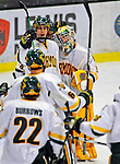 3 January 2009: University of Vermont Catamount goaltender Rob Madore, a Freshman from Venetia, PA, is congratulated by teammates after winning the championship game of the Catamount Cup Ice Hockey Tournament over the St. Lawrence Saints at Gutterson Fieldhouse in Burlington, Vermont. Madore recorded his first college career shut out against the Saints, leading the Cats to a 4-0 win and taking the tournament for the second time since its inception in 2005...Mandatory Photo Credit: Ed Wolfstein Photo