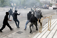 Pictured: Protesters attack riot police officers with hammers Wednesday 17 May 2017<br /> Re: Clashes between anti fourth memorandum protesters and riot police during 24 hour strike in Athens, Greece