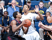 December 29th, 2012: California's Tyrone Wallace defends Harvard's Wesley Saunders during a game at Haas Pavilion in Berkeley, Ca Harvard defeated California 67 - 62