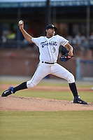 Asheville Tourists starting pitcher Antonio Senzatela #9 delivers a pitch during a game against the Savannah Sand Gnats at McCormick Field July 16, 2014 in Asheville, North Carolina. The Tourists defeated the Sand Gnats 6-3. (Tony Farlow/Four Seam Images)