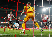 24th November 2019; Bramall Lane, Sheffield, Yorkshire, England; English Premier League Football, Sheffield United versus Manchester United; Mason Greenwood of Manchester United scores in the 77th minute to make it 2-2 beating Simon Moore of Sheffield United with Phil Jagielka  of Sheffield United and Chris Basham  of Sheffield United close by - Strictly Editorial Use Only. No use with unauthorized audio, video, data, fixture lists, club/league logos or 'live' services. Online in-match use limited to 120 images, no video emulation. No use in betting, games or single club/league/player publications