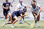 CHAPEL HILL, NC - MAY 20: Navy's Morgan Young (left) and North Carolina's Catie Woodruff (34) chase a loose ball. The University of North Carolina Tar Heels hosted the U.S. Naval Academy Midshipmen on May 20, 2017, at Fetzer Field in Chapel Hill, NC in an NCAA Women's Lacrosse Tournament Quarterfinal match. Navy won the game 16-14.