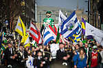© Joel Goodman - 07973 332324 . 13/03/2016 . Manchester , UK . A float featuring a gigantic jockey . The St Patrick's Day Parade , celebrating the Irish Community , through Manchester City Centre , in the Spring sunshine . Photo credit : Joel Goodman