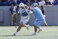 Annapolis, MD - May 20, 2018: Duke Blue Devils Brian Smyth (26) gets hit in the head during the quarterfinal game between Duke vs John Hopkins at  Navy-Marine Corps Memorial Stadium in Annapolis, MD.   (Photo by Elliott Brown/Media Images International)