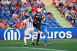 Getafe CF's David Soria (c) and Nemanja Maksimovic (r) and Real Valladolid's Kiko Olivas during La Liga match. August 31, 2018. (ALTERPHOTOS/A. Perez Meca)