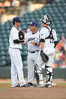 Winston-Salem Dash pitching coach J.R. Perdew (31) has a chat on the mound with starting pitcher Jordan Guerrero (23) and catcher Jeremy Dowdy (21) during the game against the Salem Red Sox at BB&T Ballpark on June 18, 2015 in Winston-Salem, North Carolina.  The Red Sox defeated the Dash 8-2.  (Brian Westerholt/Four Seam Images)