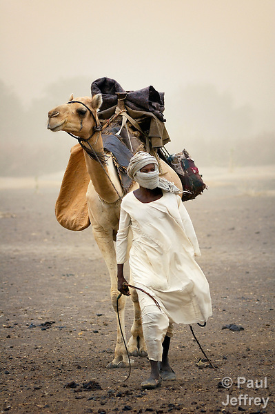 An Arab nomad travels in the Darfur region of Sudan. Historic tensions between Arab nomads and African farmers have worsened in recent years after the government in Khartoum armed Arab militias in order to strengthen their counterinsurgency campaign against regional rebels.