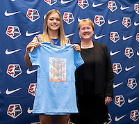 #2 overall pick Kealia Ohai of the Houston Dash stands with NWSL commissioner Cheryl Bailey during the NWSL draft at the Pennsylvania Convention Center in Philadelphia, PA, on January 17, 2014.