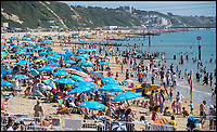 BNPS.co.uk (01202 558833)<br /> Pic: PhilYeomans/BNPS<br /> <br /> Bournemouth's booming seafront.<br /> <br /> The summer heatwave is leading to a 'bumper year' for tourism at Britain's premier seaside resort.<br /> <br /> Over 100,000 people are visiting Bournemouth, Dorset, every weekend and hotels are full to capacity, with restaurants packed and huge queues at ice cream stalls.<br /> <br /> Seafront kiosks are selling out of parasols and sun cream, while one bike hire company has reported a 50 per cent increase in business.