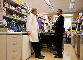 Bethesda, MD - September 30, 2009 -- United States President Barack Obama speaks with Dr. Francis Collins (L) and  Dr. Marston Linehan (2L) during a laboratory tour with Secretary of Health and Human Services (HHS) Kathleen Sebelius (R) at the National Institute of Health (NIH) in Bethesda, Maryland, Wednesday, September 30, 2009. After the visit, President Obama will make a major announcement regarding the American Recovery and Reinvestment Act  at the National Institutes of Health..Credit: Aude Guerrucci / Pool via CNP