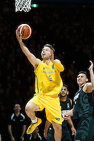 Melbourne, 15 August 2015 - Matthew DELLAVEDOVA of Australia drives to the basket in game one of the 2015 FIBA Oceania Championships in men's basketball between the Australian Boomers and the New Zealand Tall Blacks at Rod Laver Arena in Melbourne, Australia. Aus def NZ 71-59. (Photo Sydney Low / sydlow.com)