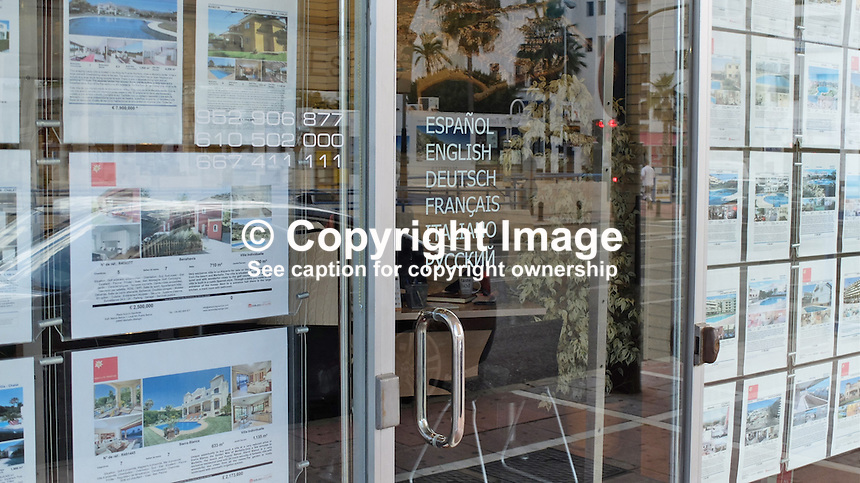 Signage in Russian on the Costa del Sol, Spain, shows its popularity with Russian ex-pats &amp; tourists. Russian now added to list of languages spoken. Estate agency, Puerto Banus, February, 2015, 201502060391<br /> <br /> Copyright Image from Victor Patterson, 54 Dorchester Park, Belfast, UK, BT9 6RJ<br /> <br /> t: +44 28 9066 1296<br /> m: +44 7802 353836<br /> vm +44 20 8816 7153<br /> <br /> e1: victorpatterson@me.com<br /> e2: victorpatterson@gmail.com<br /> <br /> www.victorpatterson.com<br /> <br /> IMPORTANT: Please see my Terms and Conditions of Use at www.victorpatterson.com