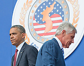 United States Secretary of Defense Chuck Hagel passes U.S. President Barack Obama prior to the President's remarks marking the 60th Anniversary of the Korean War Armistice at the Korean War Veterans Memorial in Washington, D.C. on Saturday, July 27, 2013.<br /> Credit: Ron Sachs / Pool via CNP