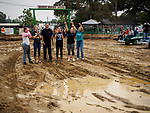A long time tradition: Miss Amador and her court run and drive into the mud with the winner of the most beautiful derby car during the Destruction Derby, Sunday, at the 80th Amador County Fair, Plymouth, Calif.<br /> .<br /> .<br /> .<br /> .<br /> #AmadorCountyFair, #1SmallCountyFair, #PlymouthCalifornia, #TourAmador, #VisitAmador