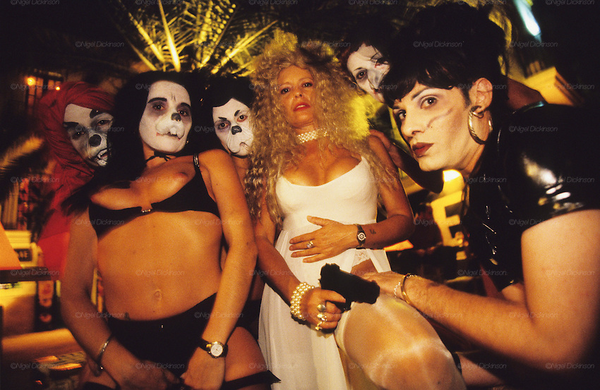 TOURISM CLUBBING, Ibiza. Drag queens. Ibiza & Formentera, Baleares islands, Spain, Mediterranean, Europe. Popular holiday resort catering mainly for european tourists. Summer high season, April until September. Well known for 24 hour nightclubbing, package holidays, jet set, all night raves, dancing, techno clubs, drag queens & gay scene, discotheques, speciality theme nights, soapsuds, foam parties, espuma, la mousse. Attractions include shopping, beaches, watersports, boating..