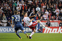 Miguel Lopez (25) of the Los Angeles Galaxy and Teemu Tainio (2) of the New York Red Bulls look to play the ball. The New York Red Bulls defeated the Los Angeles Galaxy 2-0 during a Major League Soccer (MLS) match at Red Bull Arena in Harrison, NJ, on October 4, 2011.