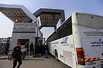 A picture taken on November 18, 2017 shows a bus waiting to cross at the gates of the Rafah border crossing with Egypt in the southern Gaza strip, with Palestinian security forces standing outside, as the crossing opened for three days for the first time since the Palestinian reconciliation deal. Only humanitarian cases registered with the Palestinian Interior ministry would be allowed to leave through the crossing, however, with this including up to 20,000 people in the empoverished enclave of two million, he added. That Egypt-brokered Palestinian reconciliation deal is expected to lead to more regular opening of the Rafah crossing, which had been totally sealed since August 2017, and was largely closed by Cairo for years beforehand. Photo by Yasser Qudih