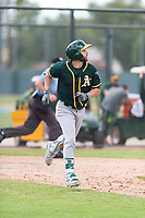 Oakland Athletics designated hitter Dustin Fowler (37) jogs down the first base line during a rehab start in an exhibition game against Team Italy at Lew Wolff Training Complex on October 3, 2018 in Mesa, Arizona. (Zachary Lucy/Four Seam Images)
