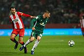 13th April 2018, Estadi Montilivi, Girona, Spain; La Liga football, Girona versus Real Betis; Cristhian Stuani of Girona and Javi Garcia of Betis challenges a ball