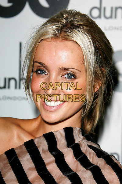 LOUISE REDKNAPP.Attending the GQ Men Of The Year Awards 2009 held at the Royal Opera House, Covent Garden, London, England, UK, September 8th 2009..arrivals portrait headshot black and brown striped smiling hair up tanned skin one shoulder .CAP/DAR.©Darwin/Capital Pictures.