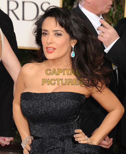 Salma Hayek.Arrivals at the 70th Annual Golden Globe Awards held at the Beverly Hilton Hotel, Hollywood, California, USA..January 13th, 2013.globes half length black blue strapless dress hands on hips belt sparkly turquoise earrings.CAP/GAG.©GAG/Capital Pictures