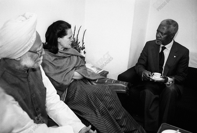 During a visit to Parliament, Secretary-General of the UN Kofi Annan speaks with some of its members, including Sonia Gandhi (center), Delhi, India, March 2001.
