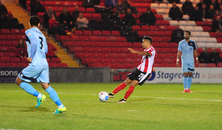 Lincoln City's Nathan Arnold scores the opening goal <br /> <br /> Photographer Andrew Vaughan/CameraSport<br /> <br /> Vanarama National League - Lincoln City v Boreham Wood - Tuesday 25th October 2016 - Sincil Bank - Lincoln<br /> <br /> World Copyright &copy; 2016 CameraSport. All rights reserved. 43 Linden Ave. Countesthorpe. Leicester. England. LE8 5PG - Tel: +44 (0) 116 277 4147 - admin@camerasport.com - www.camerasport.com