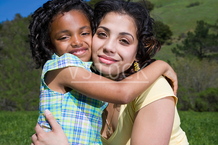 USA California, Fairfax, portrait of mother and daughter (6-7) hugging outdoors