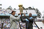 26 September 2015: Former UNC basketball players James Michael McAdoo (left) and Harrison Barnes (right) hold the NBA's Larry O'Brien Championship Trophy they won as members of the 2014-15 Golden State Warriors. The University of North Carolina Tar Heels hosted the University of Delaware Blue Hens at Kenan Memorial Stadium in Chapel Hill, North Carolina in a 2015 NCAA Division I College Football game. UNC won the game 41-14.