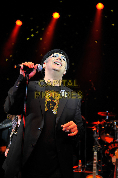 Boy George (born George Alan O'Dowd).performing for Marc Bolan's 35th anniversary concert in aid of the PRS for Music Members Benevolent Fund, Shepherd's Bush Empire, London, England. .15th September 2012.on stage in concert live gig performance performing music half length  jacket black singing  .CAP/MAR.© Martin Harris/Capital Pictures.