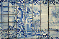 The fox and the grapes, from the fables of La Fontaine, traditional blue and white azulejos tile scene, 18th century, in the cloister of the Monastery of Sao Vicente de Fora, an Augustinian order monastery and church built in the 17th century in Mannerist style, Lisbon, Portugal. The monastery also contains the royal pantheon of the Braganza monarchs of Portugal. Picture by Manuel Cohen