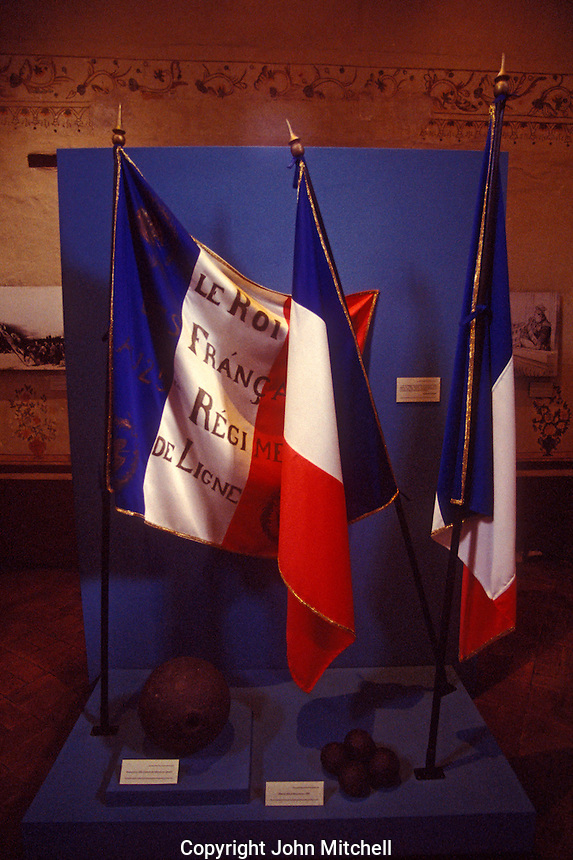 French flags and cannon balls display, National Museum of Interventions, Coyoacan, Mexico City.