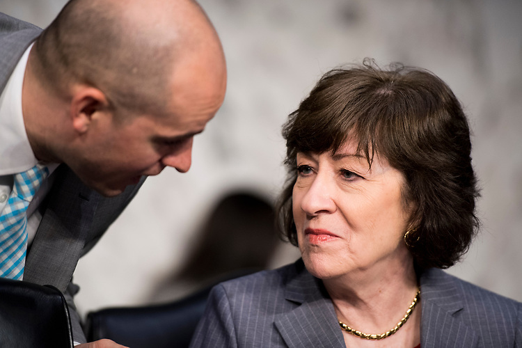 "UNITED STATES - MAY 11: Sen. Susan Collins, R-Maine, speaks with a staffer before the start of the Senate (Select) Intelligence Committee hearing on ""World Wide Threats"" on Thursday, May 11, 2017. (Photo By Bill Clark/CQ Roll Call)"