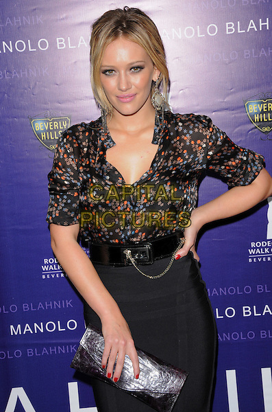 HILARY DUFF .The Rodeo Drive Walk of Style Awards Honoring Manolo Blahnik in Beverly Hills, California, USA. .September 25th, 2008.half length black skirt blouse silk satin pattern clutch bag purple belt floral print           nail varnish polish hand on hip .CAP/DVS.©Debbie VanStory/Capital Pictures.