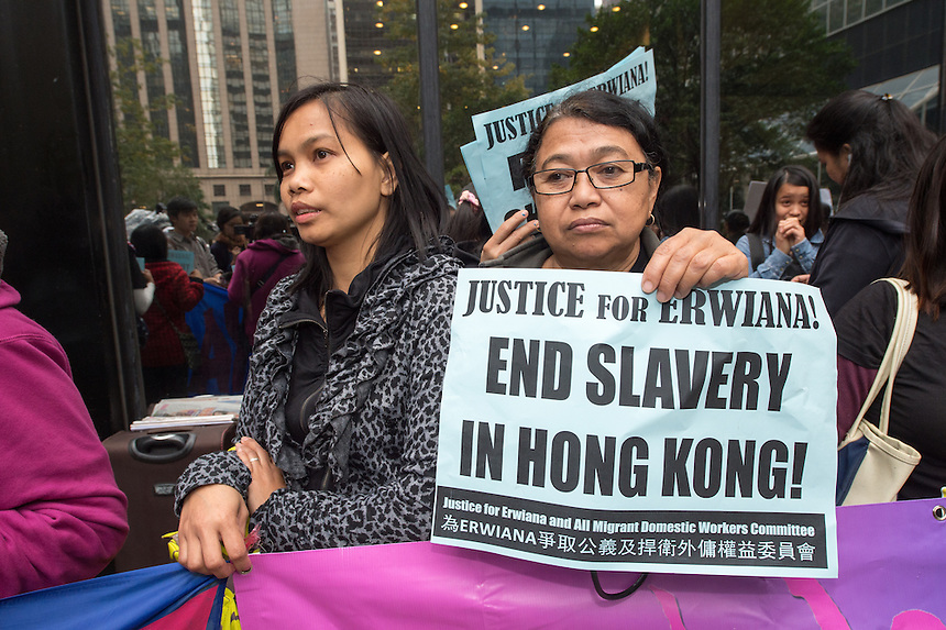 Migrant workers protest on the steps of the District court Wan Chai Hong Kong.She suffered abuse at the hands of Law Wan-Tung.27th February 2015. 27.02.15.©Jayne Russell