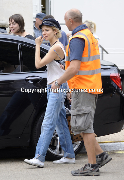 EXCLUSIVE ALL ROUND PICTURE: PERRY SMYLEE / MATRIXPICTURES.CO.UK<br /> PLEASE CREDIT ALL USES<br /> <br /> WORLD RIGHTS<br /> <br /> American born English actress Sienna Miller is pictured on the set of Adam Jones in London.<br /> <br /> Adam Jones, which has just begun shooting, stars Bradley Cooper as a rock-star chef who is known for his wild style and creating explosions of taste.<br /> <br /> JULY 28th 2014<br /> <br /> REF: PSE 143503