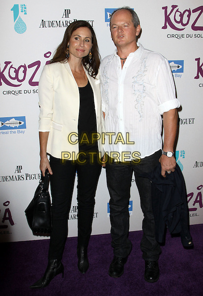 MINNIE DRIVER & CRAIG ZOLEZZI.KOOZA, the big top touring show from Cirque du Soleil held At The Santa Monica Pier, Santa Monica, California, USA..October 16th, 2009.full length black jeans denim cream jacket white shirt couple bag purse .CAP/ADM/KB.©Kevan Brooks/AdMedia/Capital Pictures.
