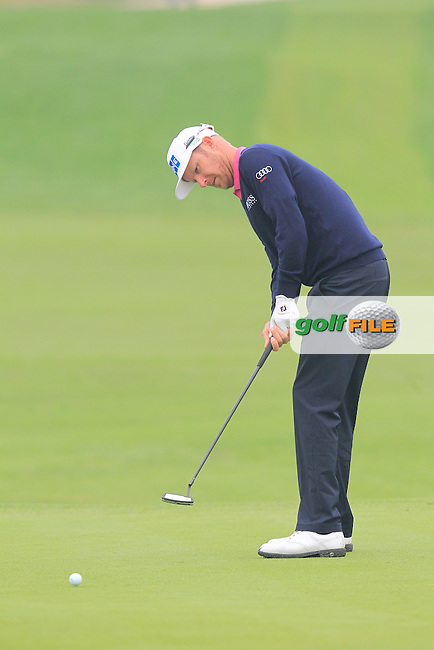 Mikko Ilonen (FIN) putts on the 17th green during Saturay's Round 3 of the 2014 BMW Masters held at Lake Malaren, Shanghai, China. 1st November 2014.<br /> Picture: Eoin Clarke www.golffile.ie