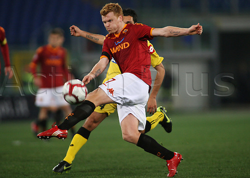 20th March 2010: John Arne Riise takes a shot on goal during the match for the Italian Serie A Soccer Roma verses Udinese at the Olympic Stadium, Rome.