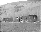 Bunk cars in Rico yard.<br /> RGS  Rico, CO  Taken by Payne, Andy M. - 5/20/1967