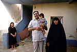 Marsh Arabs. Southern Iraq.  Marsh Arab man  wife and children Baghdad. 1984