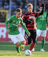 FUSSBALL   1. BUNDESLIGA   SAISON 2011/2012    20. SPIELTAG  05.02.2012 SC Freiburg - SV Werder Bremen Tom Trybull (li, SV Werder Bremen) Anton Putsila (SC Freiburg)