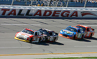 Dave Blaney (36) leads Kevin Harvick (29), Kyle Busch (18) and Joey Logano (20) late in the Aaron's 499 at Talladega Superspeedway, Talladega, AL, April 17, 2011.  (Photo by Brian Cleary/www.bcpix.com)