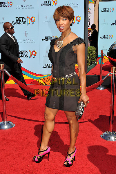 ELISE NEAL.2009 BET Awards - Arrivals held at the Shrine Auditorium, Los Angeles, CA, USA..June 28th, 2009.full length brown dress gold belt pink black shoes clutch bag .CAP/ADM/BP.©Byron Purvis/AdMedia/Capital Pictures.