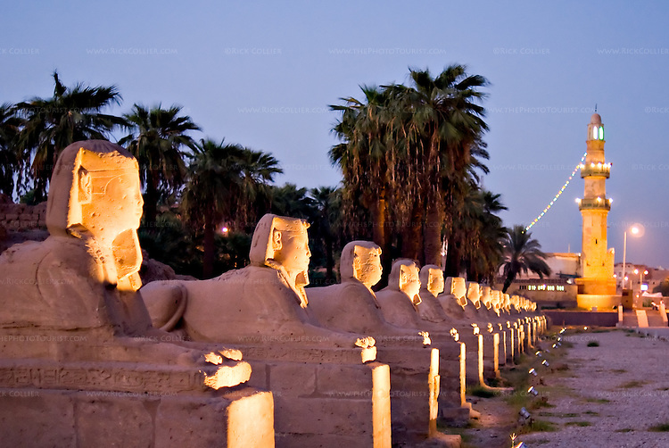 "Luxor, Egypt -- Sphinxes line both sides of the road approaching Luxor Temple.  The road originally extended all the way between Karnak and Luxor temples.  (Today, the road ends at stairs to a mosque, the minaret of which is visible at the ""end"" of the road.) © Rick Collier / RickCollier.com"