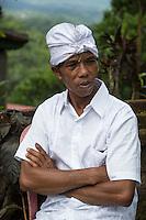 Jatiluwih, Bali, Indonesia.  Balinese Hindu Man Wearing an Udeng, the Traditional Male Head Wrap.   Luhur Bhujangga Waisnawa Hindu Temple.