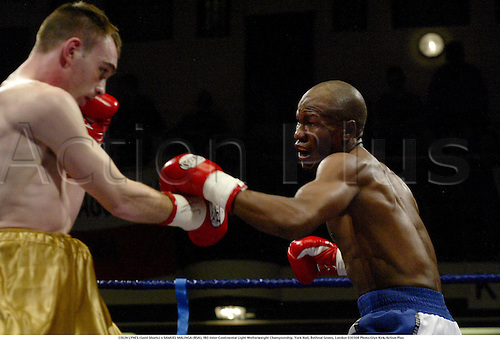 COLIN LYNES (Gold Shorts) v SAMUEL MALINGA (RSA), IBO Inter-Continental Light-Welterweight Championship. York Hall, Bethnal Green, London 030308 Photo:Glyn Kirk/Action Plus...2003 boxers boxing boxer.