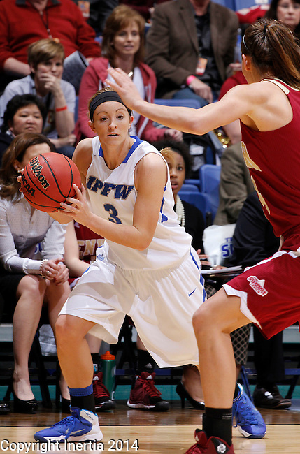 SIOUX FALLS, SD - MARCH 9:  Stefanie Mauk #3 of IPFW looks past a Denver defender during their quarterfinal game at the 2014 Summit League Basketball Championships Sunday at the Sioux Falls Arena.  (Photo by Dick CarlsonInertia)