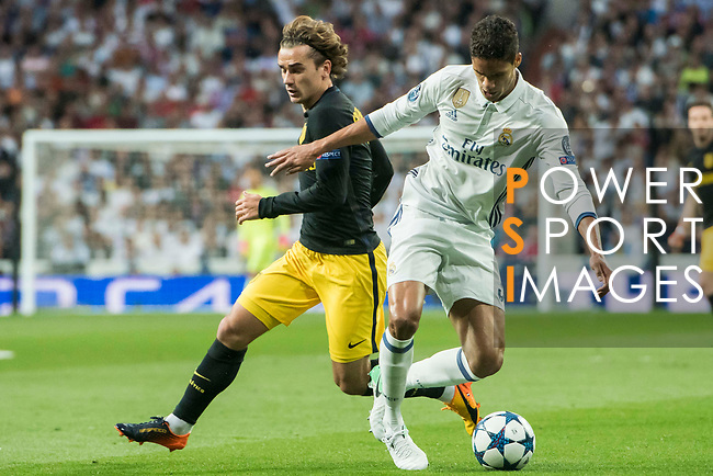 Raphael Varane (r) of Real Madrid fights for the ball with Antoine Griezmann of Atletico de Madrid during their 2016-17 UEFA Champions League Semifinals 1st leg match between Real Madrid and Atletico de Madrid at the Estadio Santiago Bernabeu on 02 May 2017 in Madrid, Spain. Photo by Diego Gonzalez Souto / Power Sport Images